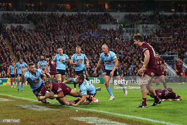 Josh Papalii of the Maroons scores a try during game three of the State of Origin series between the Queensland Maroons and the New South Wales Blues...