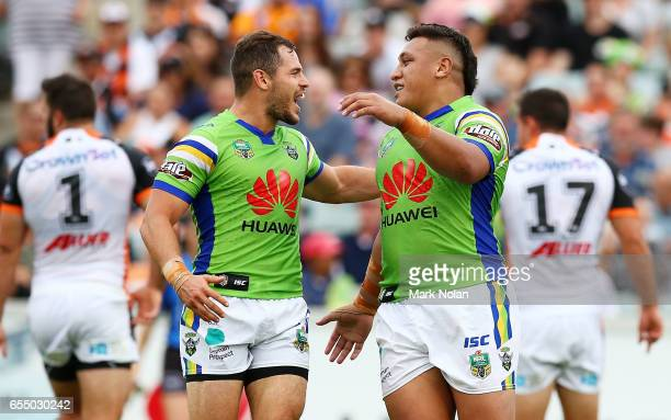 Josh Papalii of the Raiders celebrates his try with team mates during the round three NRL match between the Canberra Raiders and the Wests Tigers at...