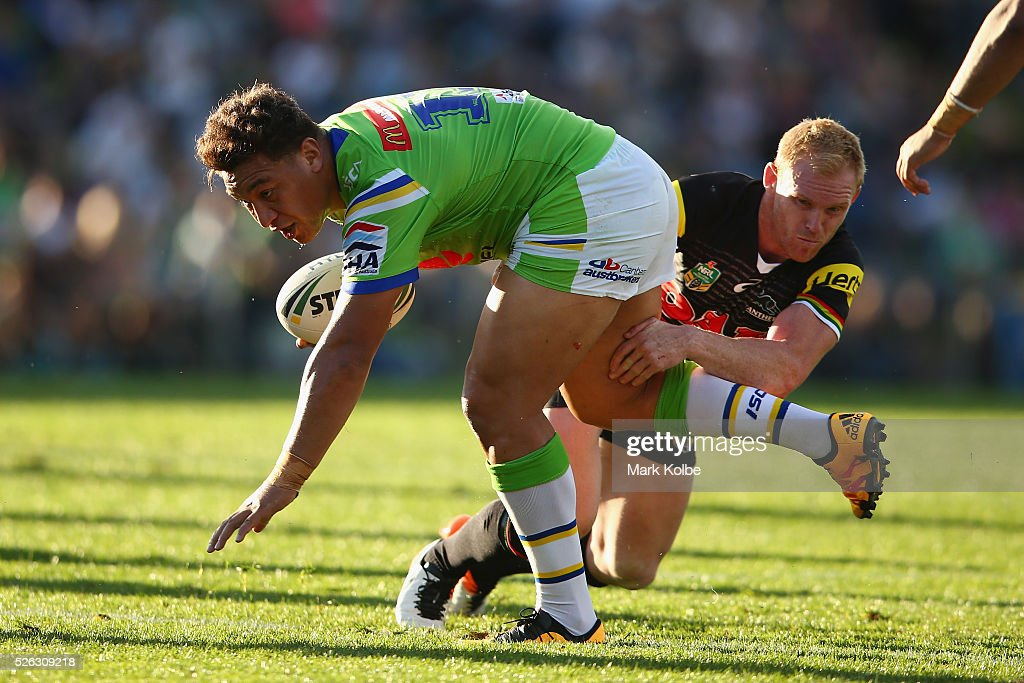 <a gi-track='captionPersonalityLinkClicked' href=/galleries/search?phrase=Josh+Papalii&family=editorial&specificpeople=7830341 ng-click='$event.stopPropagation()'>Josh Papalii</a> of the Raiders is tackled by Peter Wallace of the Panthers during the round nine NRL match between the Penrith Panthers and the Canberra Raiders at Carrington Park on April 30, 2016 in Bathurst, Australia.