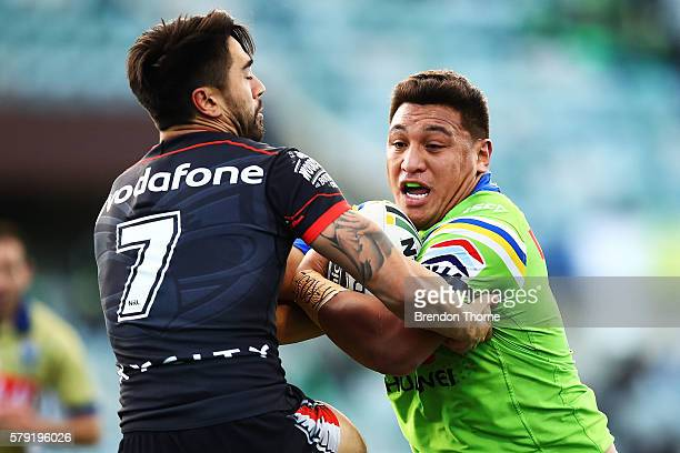 Josh Papalii of the Raiders is tackled by Shaun Johnson of the Warriors during the round 20 NRL match between the Canberra Raiders and the New...
