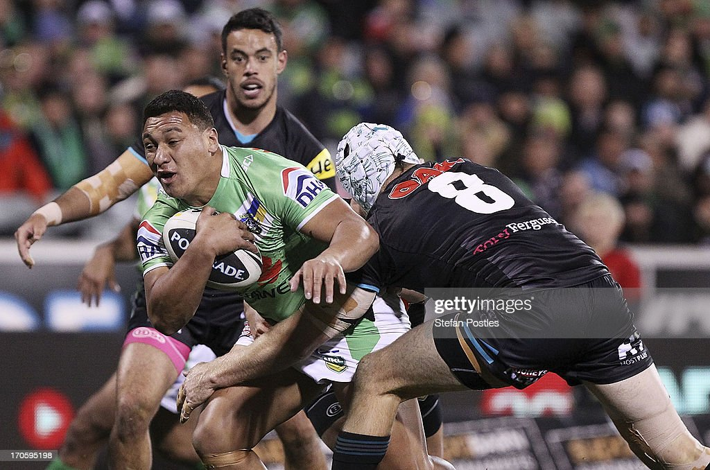 Josh Papalii of the Raiders is tackled during the round 14 NRL match between the Canberra Raiders and the Penrtih Panthers at Canberra Stadium on June 15, 2013 in Canberra, Australia.