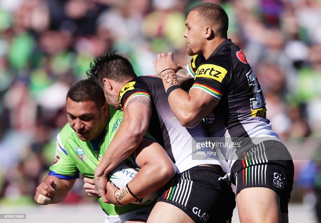 Josh Papalii of the Raiders is tackled during the round 24 NRL match between the Canberra Raiders and the Penrith Panthers at GIO Stadium on August 20, 2017 in Canberra, Australia.