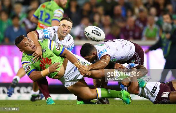 Josh Papalii of the Raiders offloads during the round eight NRL match between the Canberra Raiders and the Manly Sea Eagles at GIO Stadium on April...