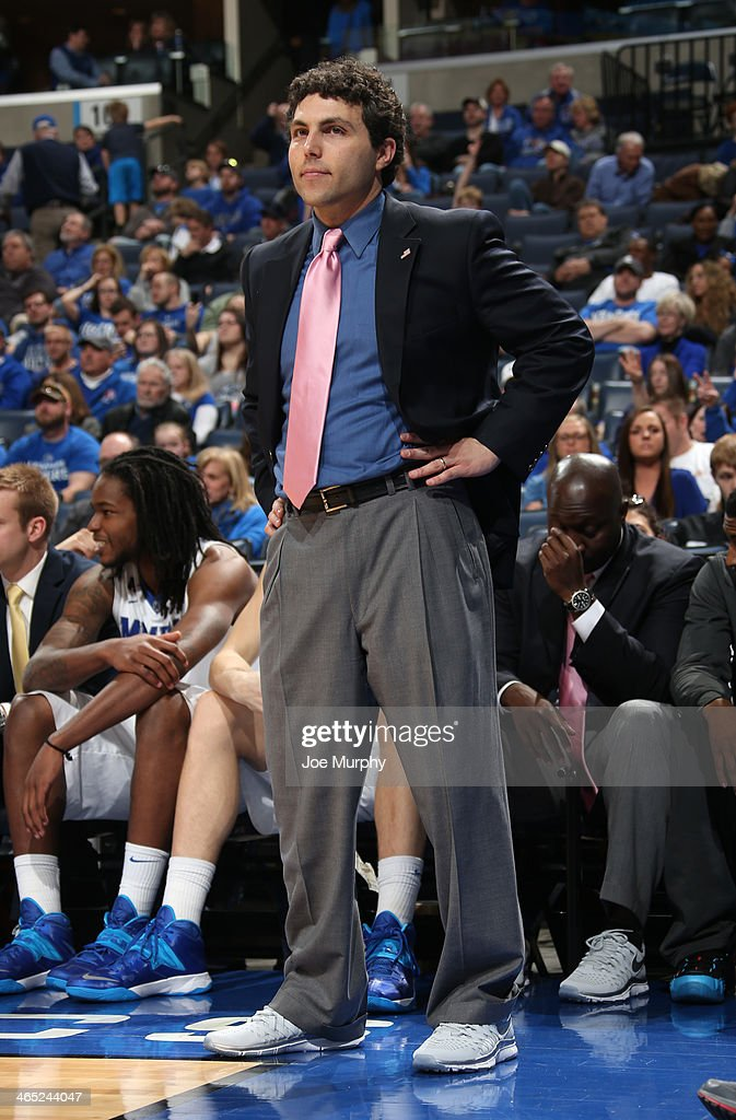 Josh Pastner, head coach of the Memphis Tigers wears sneakers and a pink tie in support of Coaches vs. Cancer against the USF Bulls on January 26, 2014 at FedExForum in Memphis, Tennessee. Memphis beat South Florida 80-58.