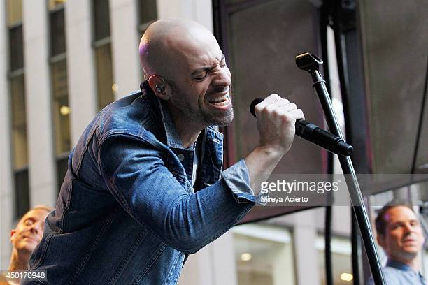 Josh Paul Chris Daughtry and Brian Craddock of Daughtry perform during 'FOX Friends' All American Concert Series outside of FOX Studios on June 6...