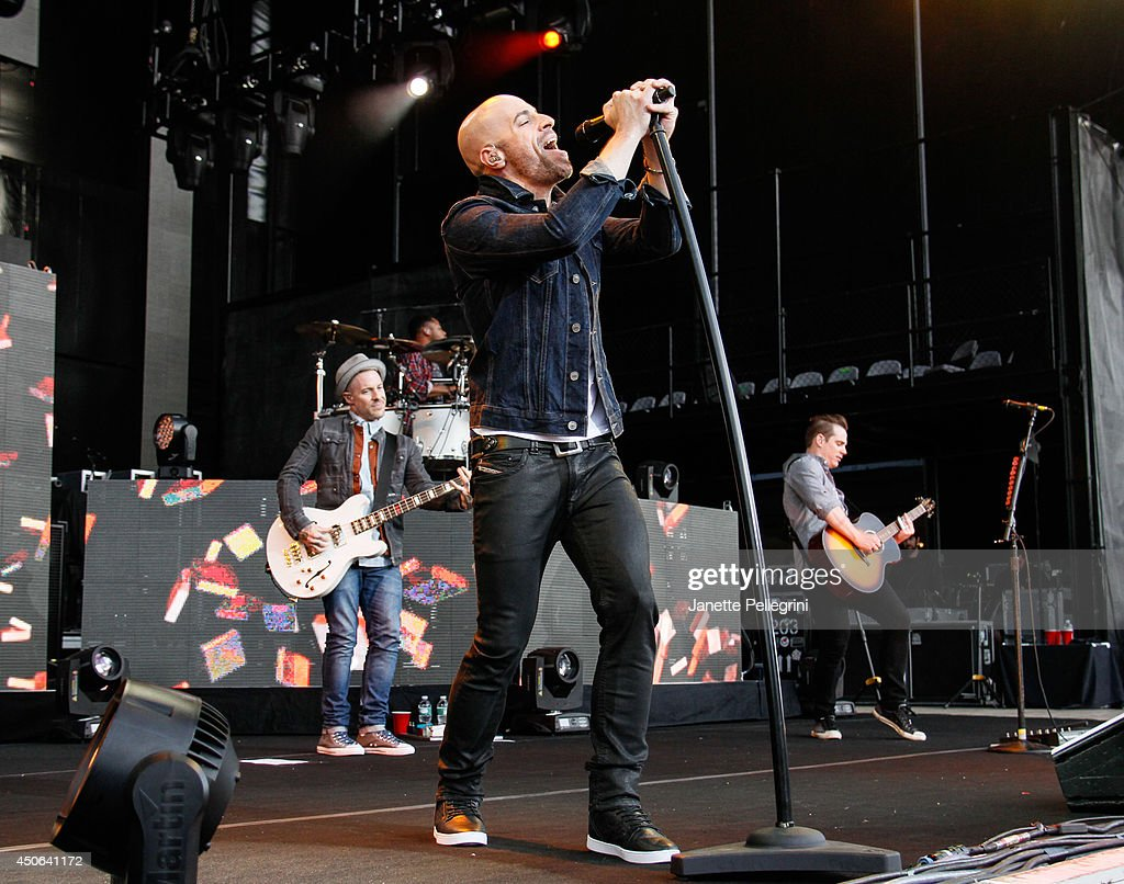 Josh Paul, <a gi-track='captionPersonalityLinkClicked' href=/galleries/search?phrase=Chris+Daughtry&family=editorial&specificpeople=614842 ng-click='$event.stopPropagation()'>Chris Daughtry</a> and Brian Craddock of Daughtry perform in concert at Nikon at Jones Beach Theater on June 14, 2014 in Wantagh, New York.