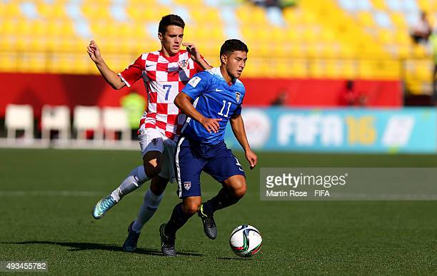 Josh Perez of USA and Josip Brekalo of Croatia battle for the ball during the FIFA U17 Men's World Cup 2015 group A match between USA and Croatia at...