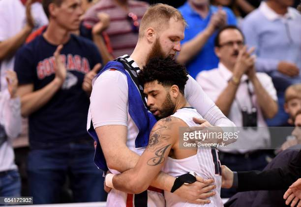 Josh Perkins and Przemek Karnowski of the Gonzaga Bulldogs hug in the second half against the South Dakota State Jackrabbits during the first round...