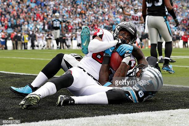 Josh Perkins of the Atlanta Falcons catches a touchdown pass against Thomas Davis and teammate James Bradberry of the Carolina Panthers in the 1st...