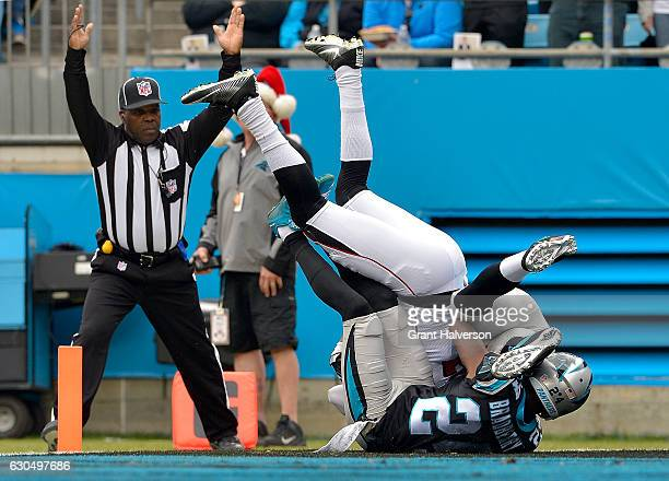 Josh Perkins of the Atlanta Falcons catches a touchdown pass against James Bradberry of the Carolina Panthers in the 1st quarter during the game at...