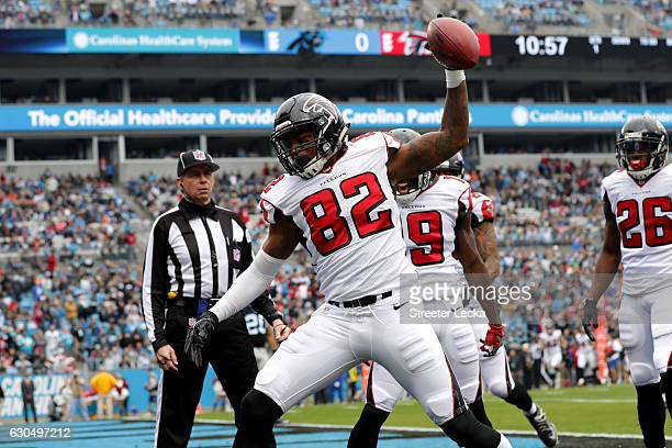 Josh Perkins of the Atlanta Falcons celebrates a touchdown against the Carolina Panthers in the 1st quarter during their game at Bank of America...