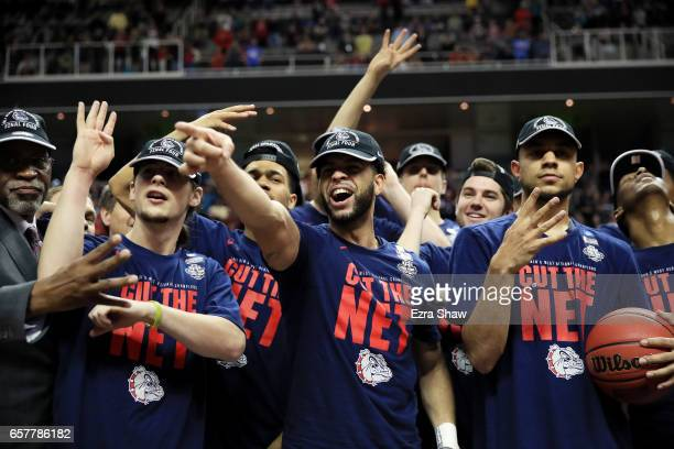Josh Perkins of the Gonzaga Bulldogs and teammates celebrate their 83 to 59 win over the Xavier Musketeers during the 2017 NCAA Men's Basketball...