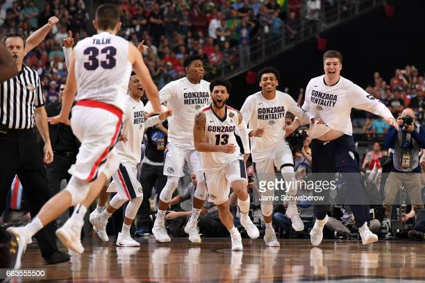 Josh Perkins of the Gonzaga Bulldogs and teammates react after winning during the 2017 NCAA Men's Final Four Semifinal against the South Carolina...