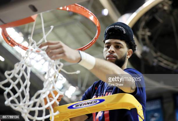Josh Perkins of the Gonzaga Bulldogs cuts down the net after their 83 to 59 win over the Xavier Musketeers during the 2017 NCAA Men's Basketball...