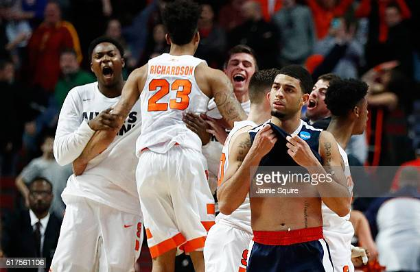 Josh Perkins of the Gonzaga Bulldogs reacts as the Syracuse Orange celebrate their 63 to 60 win during the 2016 NCAA Men's Basketball Tournament...