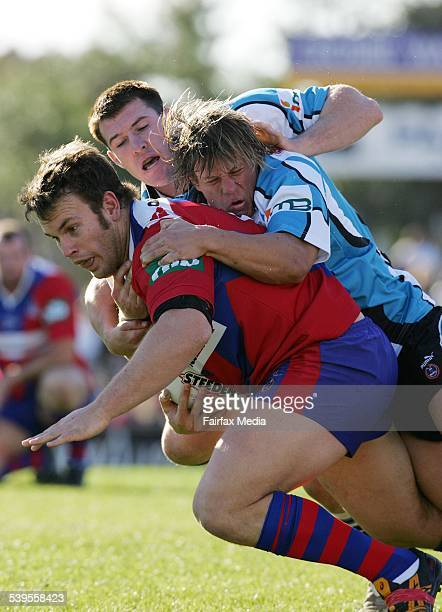 Josh Perry in action during Newcastle Knghts vs Sharks encounter at Energy Australia stadium 4 July 2004 NCH Picture by DARREN PATEMAN