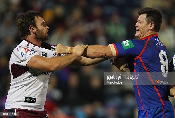 Josh Perry of the Eagles and Ben Cross of the Knight exchange heated words during the round 21 NRL match between the Newcastle Knights and the Manly...