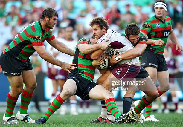 Josh Perry of the Eagles is tackled during the round eight NRL match between the South Sydney Rabbitohs and the Manly Sea Eagles at ANZ Stadium on...