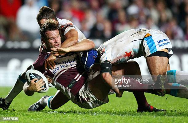 Josh Perry of the Eagles is tackled during the round seven NRL match between the Manly Sea Eagles and the Gold Coast Titans at Brookvale Oval on...