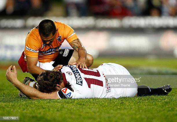 Josh Perry of the Sea Eagles receives treatment after taking a knock during the round 22 NRL match between the Manly Sea Eagles and the Melbourne...