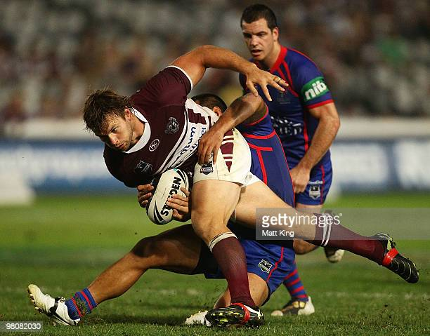 Josh Perry of the Sea Eagles takes on the defence during the round three NRL match between the Manly Warringah Sea Eagles and the Newcastle Knights...