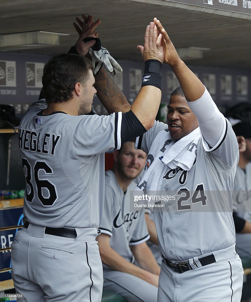Josh Phegley #36 of the Chicago White Sox is congratulated by <a gi-track='captionPersonalityLinkClicked' href=/galleries/search?phrase=Dayan+Viciedo&family=editorial&specificpeople=5720224 ng-click='$event.stopPropagation()'>Dayan Viciedo</a> #24 after hitting a grand slam against the Detroit Tigers in the sixth inning at Comerica Park on July 11, 2013 in Detroit, Michigan.