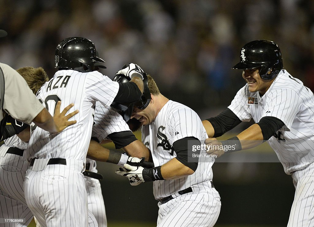 Josh Phegley #36 of the Chicago White Sox (C) is mobbed by teammates <a gi-track='captionPersonalityLinkClicked' href=/galleries/search?phrase=Alejandro+De+Aza&family=editorial&specificpeople=4181650 ng-click='$event.stopPropagation()'>Alejandro De Aza</a> #30, Avisail Garcia #26 (R) and others after he hit a game-winning, RBI single scoring Garcia during the ninth inning of the 2013 Civil Rights Game against the Texas Rangers at U.S. Cellular Field on August 24, 2013 in Chicago, Illinois. The White Sox won 3-2.