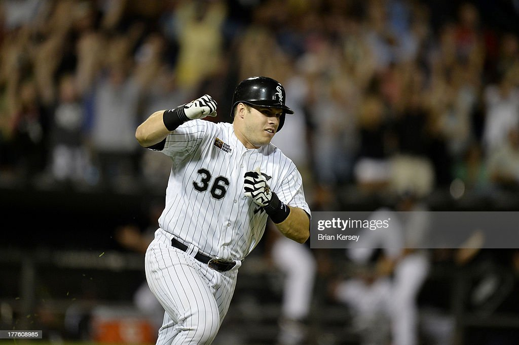 Josh Phegley #36 of the Chicago White Sox pumps his fist as he runs up the first base line after hitting a game-winning, RBI single scoring teammate Avisail Garcia #26 during the ninth inning of the 2013 Civil Rights Game against the Texas Rangers at U.S. Cellular Field on August 24, 2013 in Chicago, Illinois. The White Sox won 3-2.
