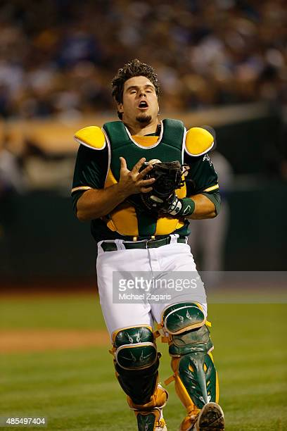 Josh Phegley of the Oakland Athletics catches a foul ball during the game against the Los Angeles Dodgers at Oco Coliseum on August 18 2015 in...