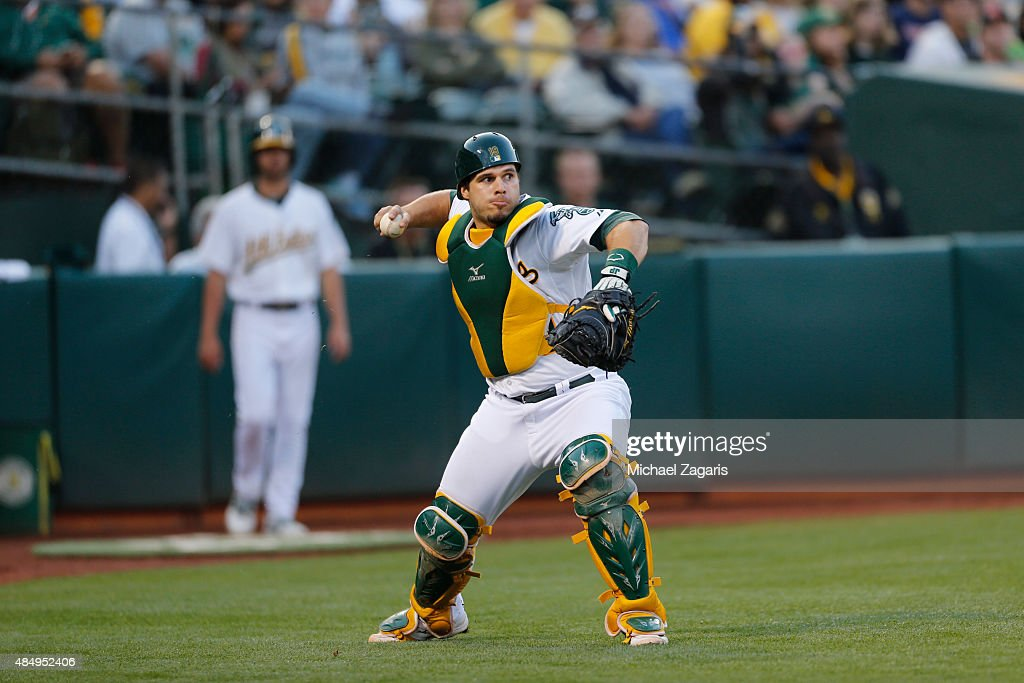<a gi-track='captionPersonalityLinkClicked' href=/galleries/search?phrase=Josh+Phegley&family=editorial&specificpeople=6796472 ng-click='$event.stopPropagation()'>Josh Phegley</a> #19 of the Oakland Athletics fields a passed ball during the game against the Houston Astros at O.co Coliseum on August 7, 2015 in Oakland, California. The Athletics defeated the Astros 3-1.