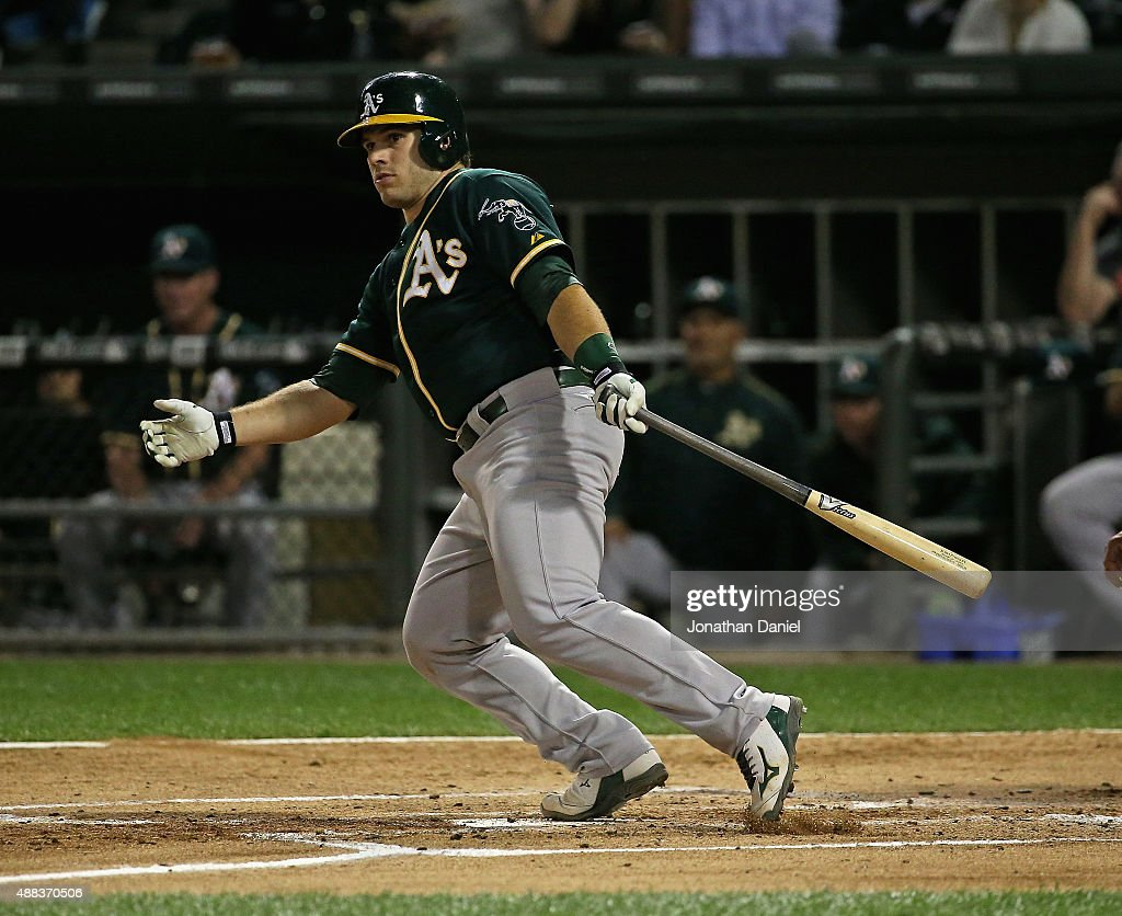 <a gi-track='captionPersonalityLinkClicked' href=/galleries/search?phrase=Josh+Phegley&family=editorial&specificpeople=6796472 ng-click='$event.stopPropagation()'>Josh Phegley</a> #19 of the Oakland Athletics hits a run-scoring double in the 1st inning against the Chicago White Sox at U.S. Cellular Field on September 15, 2015 in Chicago, Illinois.