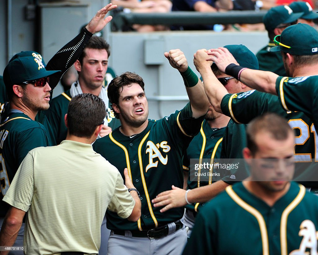 <a gi-track='captionPersonalityLinkClicked' href=/galleries/search?phrase=Josh+Phegley&family=editorial&specificpeople=6796472 ng-click='$event.stopPropagation()'>Josh Phegley</a> #19 of the Oakland Athletics is greeted by his teammates after scoring against the Chicago White Sox during the third inning on September 17, 2015 at U.S. Cellular Field in Chicago, Illinois.