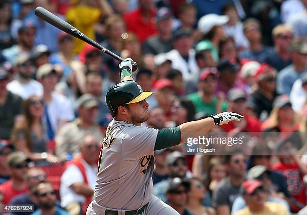 Josh Phegley of the Oakland Athletics knocks in a run in the fourth inning against the Boston Red Sox at Fenway Park on June 7 2015 in Boston...