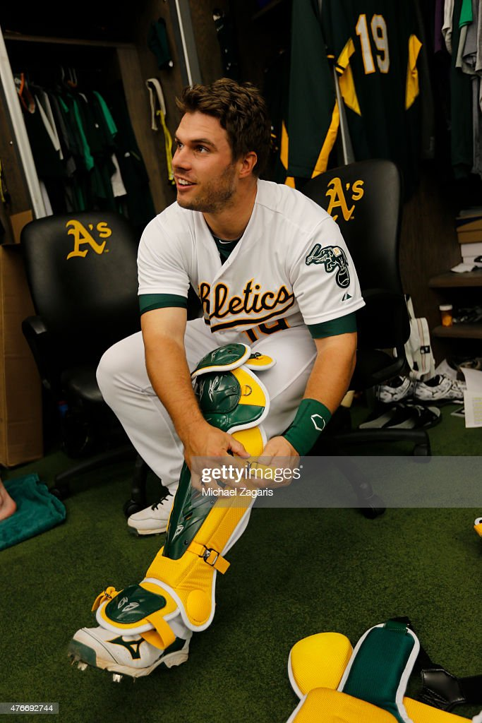 <a gi-track='captionPersonalityLinkClicked' href=/galleries/search?phrase=Josh+Phegley&family=editorial&specificpeople=6796472 ng-click='$event.stopPropagation()'>Josh Phegley</a> #19 of the Oakland Athletics puts his catchers gear on in the clubhouse prior to the game against the Chicago White Sox at O.co Coliseum on May 15, 2015 in Oakland, California. The White Sox defeated the Athletics 7-6.
