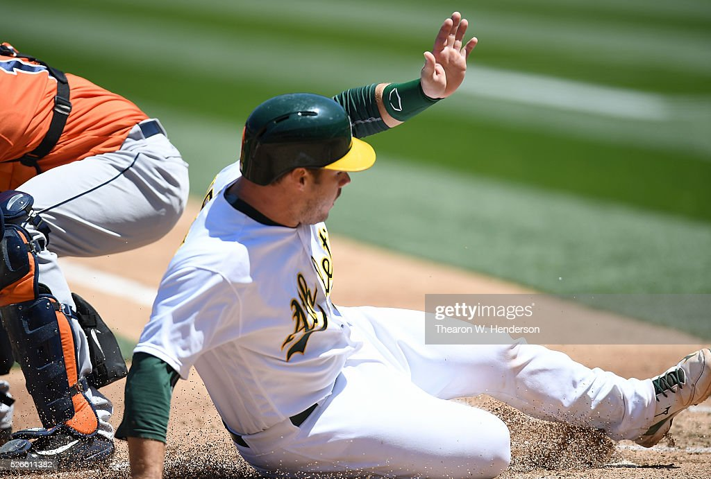 <a gi-track='captionPersonalityLinkClicked' href=/galleries/search?phrase=Josh+Phegley&family=editorial&specificpeople=6796472 ng-click='$event.stopPropagation()'>Josh Phegley</a> #19 of the Oakland Athletics scores against the Houston Astros in the bottom of the second inning at O.co Coliseum on April 30, 2016 in Oakland, California.