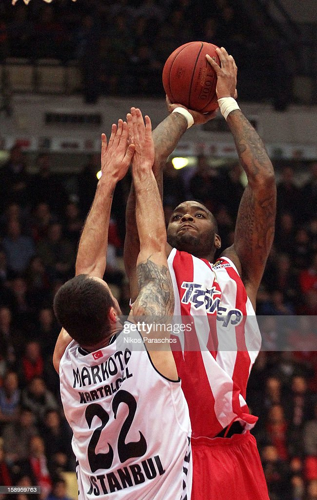 Josh Powell, #12 of Olympiacos Piraeus competes with in action during the 2012-2013 Turkish Airlines Euroleague Top 16 Date 2 between Olympiacos Piraeus v Besiktas JK Istanbul at Peace and Friendship Stadium on January 4, 2013 in Athens, Greece.