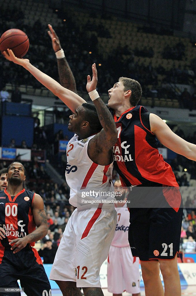 <a gi-track='captionPersonalityLinkClicked' href=/galleries/search?phrase=Josh+Powell&family=editorial&specificpeople=546627 ng-click='$event.stopPropagation()'>Josh Powell</a>, #12 of Olympiacos Piraeus competes with <a gi-track='captionPersonalityLinkClicked' href=/galleries/search?phrase=Tibor+Pleiss&family=editorial&specificpeople=4538830 ng-click='$event.stopPropagation()'>Tibor Pleiss</a>, #21 of Caja Laboral Vitoria during the 2012-2013 Turkish Airlines Euroleague Top 16 Date 8 between Olympiacos Piraeus v Caja Laboral Vitoria at Peace and Friendship Stadium on February 22, 2013 in Athens, Greece.