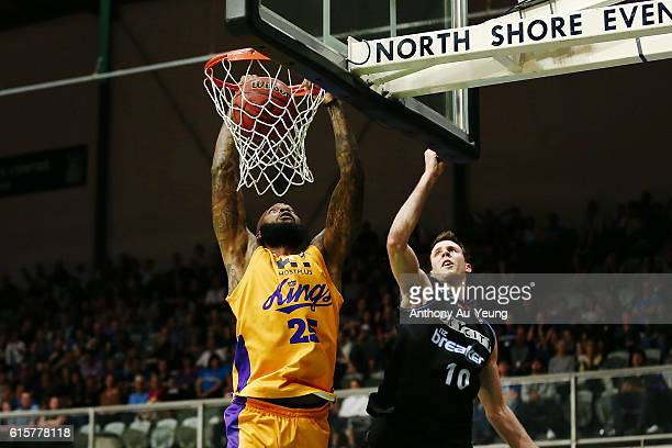 Josh Powell of Sydney with a dunk against Tom Abercrombie of New Zealand during the round three NBL match between the New Zealand Breakers and the...