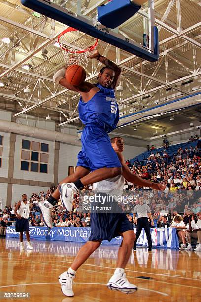 Josh Powell of the Dallas Mavericks dunks the ball against the Utah Jazz on July 19 2005 at the Reebok Rocky Mountain Revue in Salt Lake City Utah...