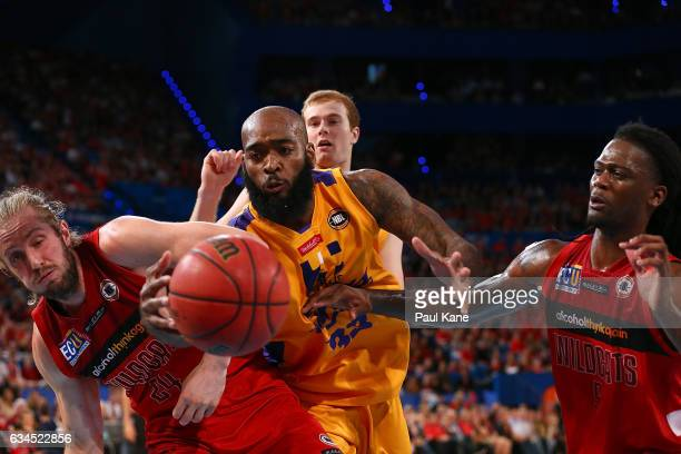 Josh Powell of the Kings contests a loose ball against Jesse Wagstaff and Jameel McKay of the Wildcats during the round 19 NBL match between the...