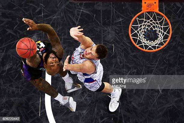 Josh Powell of the Kings drives to the basket under pressure from Anthony Drmic of the 36ers during the round eight NBL match between the Sydney...