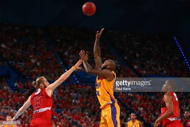 Josh Powell of the Kings puts a shot up against Jesse Wagstaff of the Wildcats during the round 19 NBL match between the Perth Wildcats and the...