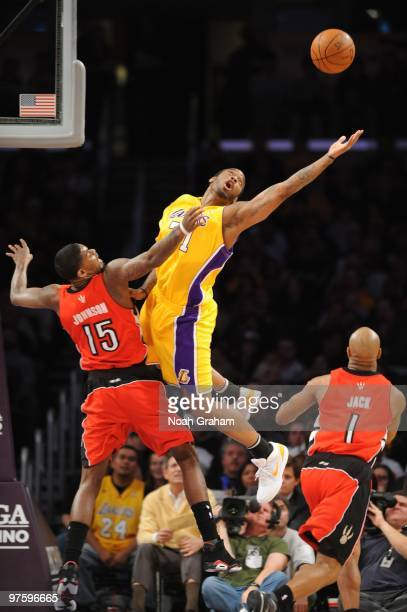 Josh Powell of the Los Angeles Lakers reaches for the ball against Amir Johnson of the Toronto Raptors at Staples Center on March 9 2010 in Los...