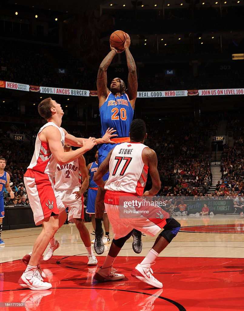 <a gi-track='captionPersonalityLinkClicked' href=/galleries/search?phrase=Josh+Powell&family=editorial&specificpeople=546627 ng-click='$event.stopPropagation()'>Josh Powell</a> #20 of the New York Knicks shoots against <a gi-track='captionPersonalityLinkClicked' href=/galleries/search?phrase=Tyler+Hansbrough&family=editorial&specificpeople=642794 ng-click='$event.stopPropagation()'>Tyler Hansbrough</a> #50 of the Toronto Raptors during the game on October 11, 2013 at the Air Canada Centre in Toronto, Ontario, Canada.