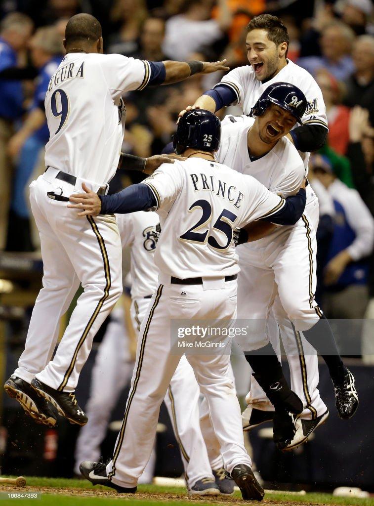 Josh Prince of the Milwaukee Brewers celebrates Jean Segura Norichika Aoki and Ryan Braun after Blake Lalli singles scoring the scoring the winning...