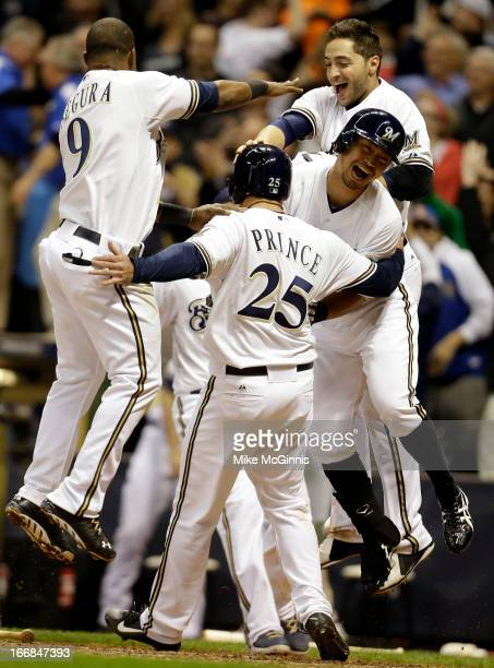 Josh Prince of the Milwaukee Brewers celebrates Jean Segura Norichika Aoki and Ryan Braun after Blake Lalli singles scoring the scoring the winning...