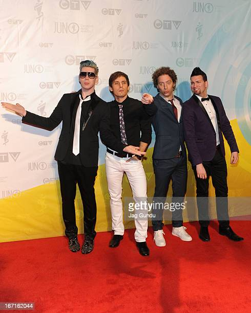 Josh Ramsay Matt Webb Mike Ayley and Ian Casselman of 'Marianas Trench' arrive at the 2013 Juno Awards held at the Brandt Centre on April 21 2013 in...