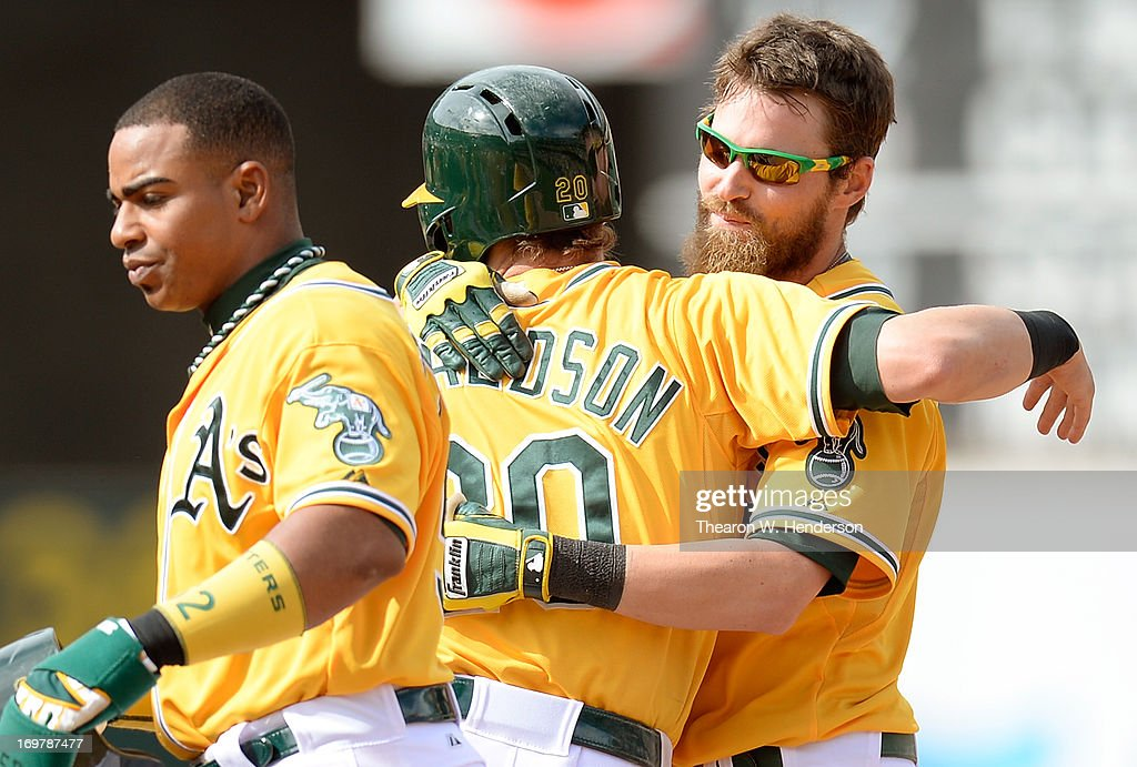 Josh Reddich #16, <a gi-track='captionPersonalityLinkClicked' href=/galleries/search?phrase=Josh+Donaldson&family=editorial&specificpeople=4959442 ng-click='$event.stopPropagation()'>Josh Donaldson</a> #20 and <a gi-track='captionPersonalityLinkClicked' href=/galleries/search?phrase=Yoenis+Cespedes&family=editorial&specificpeople=8892047 ng-click='$event.stopPropagation()'>Yoenis Cespedes</a> #52 of the Oakland Athletics celebrates after Reddick walked with the bases loaded to give the Athletics a 4-3 victory in ten inning over the Chicago White Sox at O.co Coliseum on June 1, 2013 in Oakland, California.
