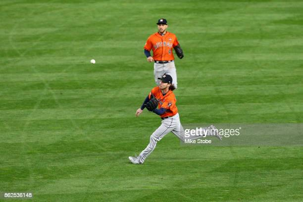 Josh Reddick of the Houston Astros catches a fly ball hit by Gary Sanchez of the New York Yankees during the fourth inning in Game Four of the...