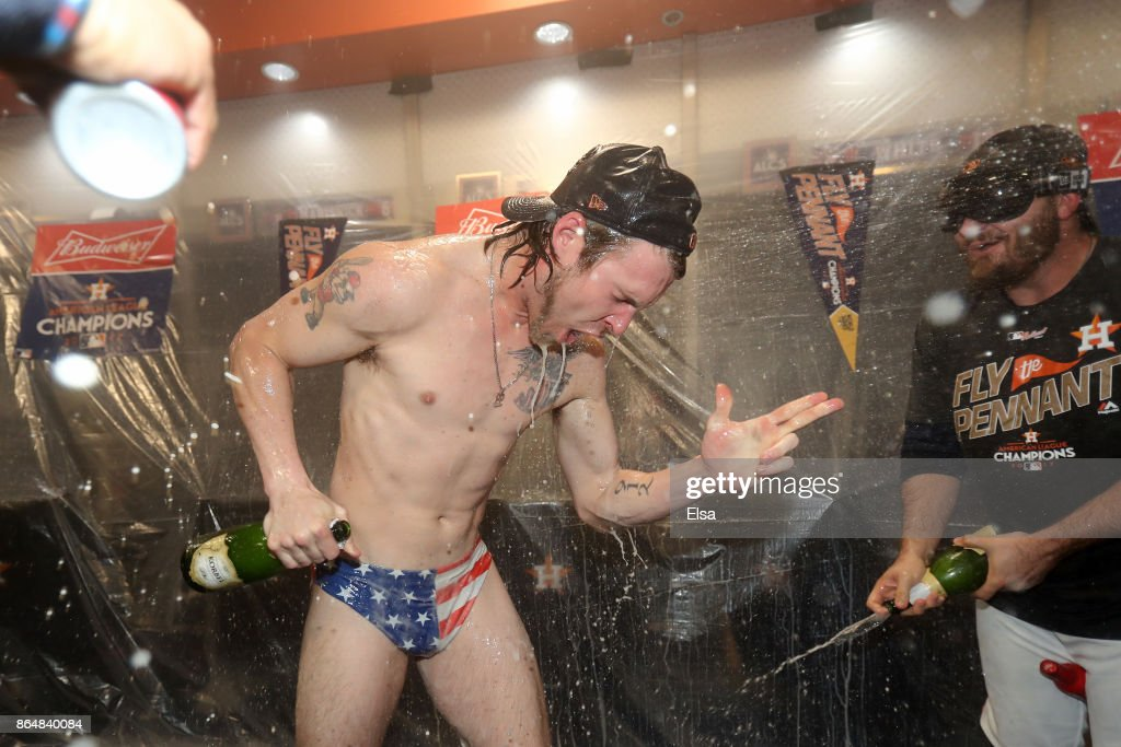 Josh Reddick #22 of the Houston Astros celebrates in the locker room after defeating the New York Yankees by a score of 4-0 to win Game Seven of the American League Championship Series at Minute Maid Park on October 21, 2017 in Houston, Texas. The Houston Astros advance to face the Los Angeles Dodgers in the World Series.